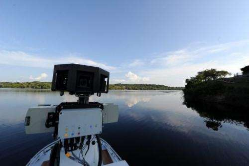 View of a 360-degree camera system mounted on a Trike atop a boat by Google team members