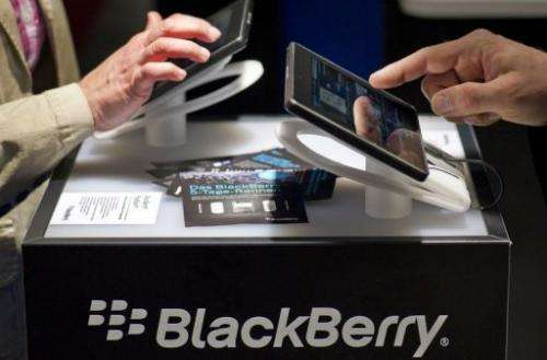 Visitors try out Blackberry tablet PC's at the CeBIT high-tech fair in Hanover