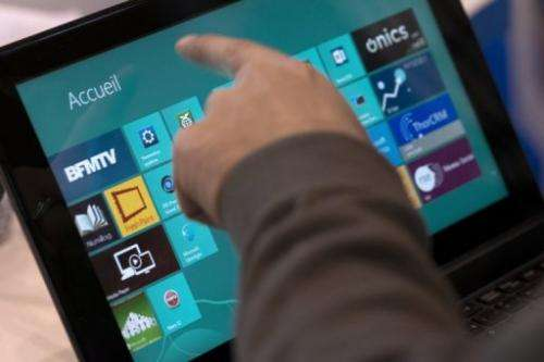 A man navigates with Windows 8 on a Tablet on November 14, 2012 in Paris