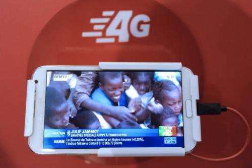 A mobile phone plays a video of BFM TV taken during the launch of the SFR 4G mobile network in Paris on January 29, 2013