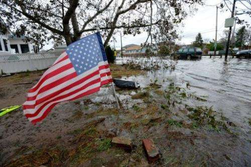 An American flag flies from the front yard of a house on October 30, 2012 in the Breezy Point area of Queens in New York