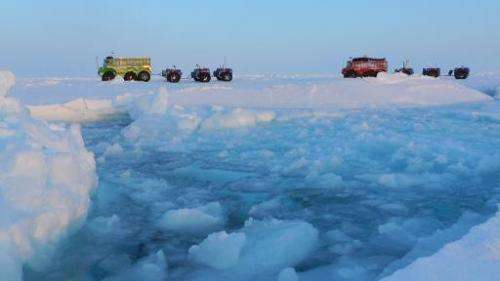An undated image released by the Marine Ice Automobile Expedition shows expedition trucks crossing the North Pole