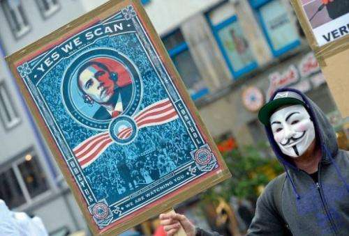 A protestor wearing a Guy Fawkes mask demonstrates against the PRISM program on June 29, 2013 in Hannover, Germany