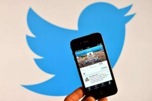 A smartphone shows the first twitter message sent by Pope Benedict XVI on December 12, 2012