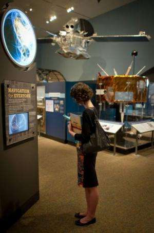 "A visitor explores the ""Time and Navigation"" exhibition at the Smithsonian National Air and Space Museum, April 10, 20"
