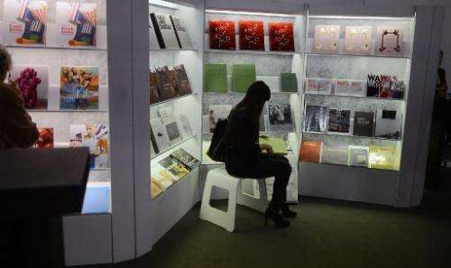 A visitor of the Frankfurt Book Fair looks at books on October 10, 2012 in Frankfurt am Main, western Germany