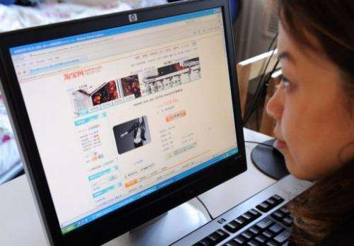 A woman in Beijing shops online at the Taobao website on February 5, 2008