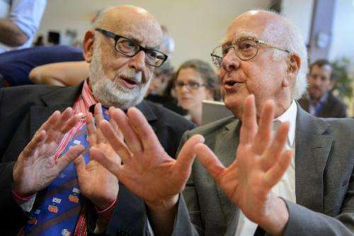 British physicist Peter Higgs (R) speaks with Belgium physicist Francois Englert at a press conference on July 4, 2012 at the Eu