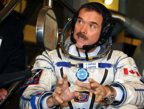 Canadian astronaut Chris Hadfield speaks with a journalist outside Moscow on November  28, 2012