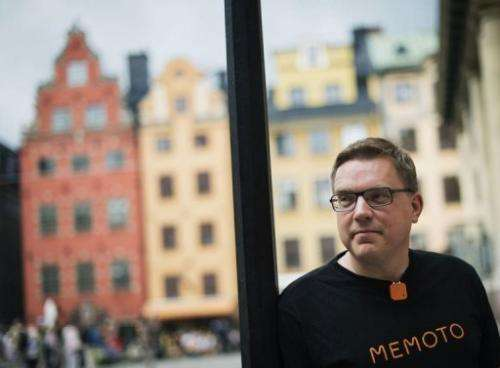 Co-founder and CEO of Memoto, Martin Kaellstroem, wears the life-logging camera in Stockholm on August 29, 2013