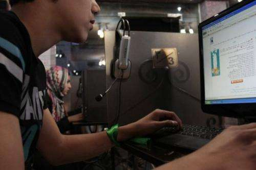 File photo shows an Iranian youth using a computer at an internet cafe in Iran's Hamadan province