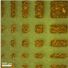 Improved adhesion and patterning of plated metal thin film by light irradiation