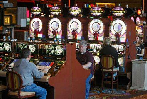 In this file photo, people play slot machines at the Mirage Hotel & Casino in Las Vegas, Nevada, on November 24, 2008