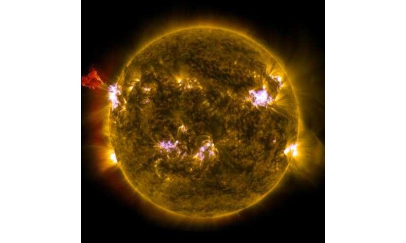 NASA sees sun emit mid-level flare