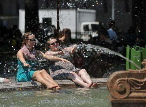 People cool off as they relax in a fountain in Bryant Park on May 30, 2013 in New York