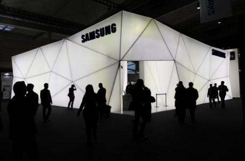 People visit the Samsung stand at the Mobile World congress in Barcelona on February 25, 2013