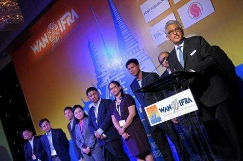 President of the WAN-IFRA, Jacob Mathew, (R), speaks in Bangkok, on June 2, 2013
