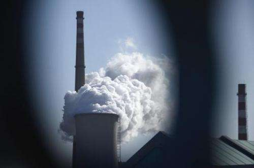 Steam rises from a power station in Beijing on December 5, 2012