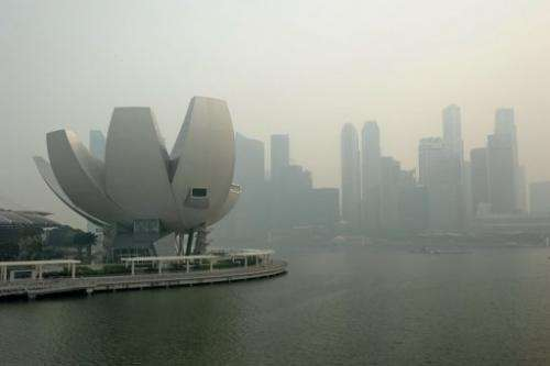 The city skyline shrouded by haze in Singapore on June 20, 2013
