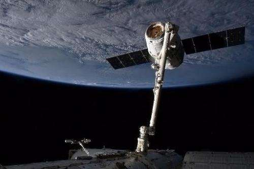 The SpaceX capsule Dragon attached to the Canada Arm at the the International Space Staion (ISS) on March 3, 2013
