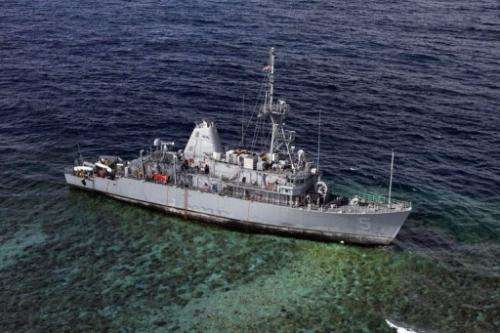The USS Guardian sits aground on January 22, 2013 on the Tubbataha Reef