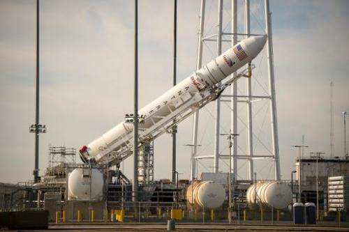 This NASA handout photo shows the Orbital Science Corporation Antares rocket seen as it is raised into position at launch Pad-0A
