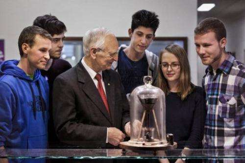 This photo released on August 26, 2013 shows John Mainstone (3rd L) with students at the University of Queensland