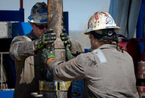 Workers change pipes at Consol Energy Horizontal Gas Drilling Rig exploring the Marcellus Shale outside the town of Waynesburg,