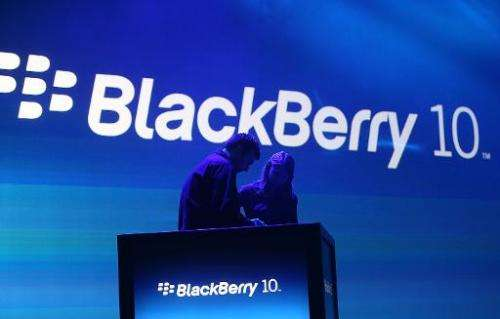 Workers prepare the podium before the start of the BlackBerry 10 launch event on January 30, 2013 in New York City