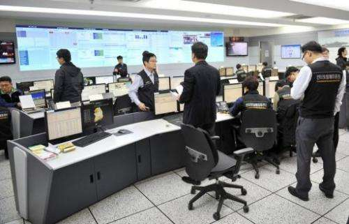 Members of the Korea Internet Security Agency investigate cyber attacks in Seoul on March 20, 2013