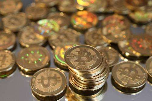 A pile of Bitcoins are shown here after Software engineer Mike Caldwell minted them in his shop on April 26, 2013 in Sandy, Utah