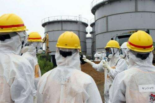 Japan's nuclear watchdog members inspect contaminated water tanks at the Fukushima nuclear power plant, August 23, 2013