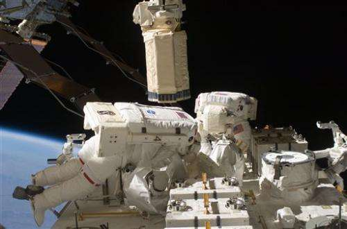 Spacewalking astronauts hope new pump stops leak