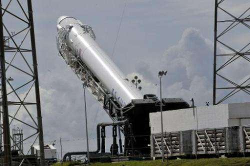 SpaceX's Falcon 9 rocket is readied on October 7, 2012 for an evening launch from Cape Canaveral, Florida