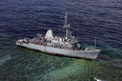 The USS Guardian sits aground on the UN World Heritage-listed Tubbataha coral reef January 22, 2013