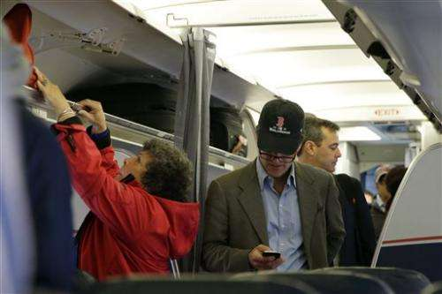 US eases rules on electronic devices on planes