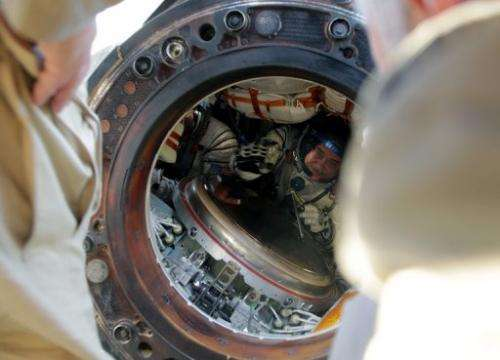 Russian cosmonauts Pavel Vinogradov is seen in a space capsule shortly after landing in Kazakhstan on September 11, 2013