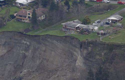 A day after Wash. landslide, examinations continue