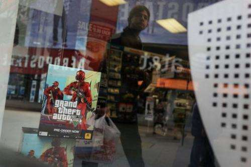 An advertisement for the new Grand Theft Auto is viewed at a Brooklyn gaming store on January 11, 2013 in New York City