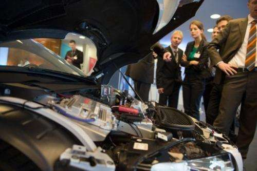 Visitors look at an Audi F12 concept car during the Electric Mobility conference on May 27, 2013 in Berlin