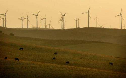 Wind turbines are seen off the coast of Barbate, southern Spain on August 30, 2006.