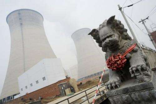 Cooling towers at a coal-fired power plant in the suburbs of Beijing on November 22, 2011