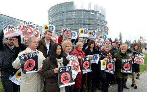"Members of the European Parliament hold banners reading, ""Stop fracking,"" November 21, 2012"