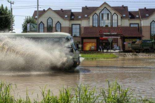 A bus operates on a flooded street, on August 21, 2013 in Khabarovsk