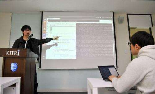 A computer research consultant teaches at the Korea Information Technology Research Institute on February 14, 2013