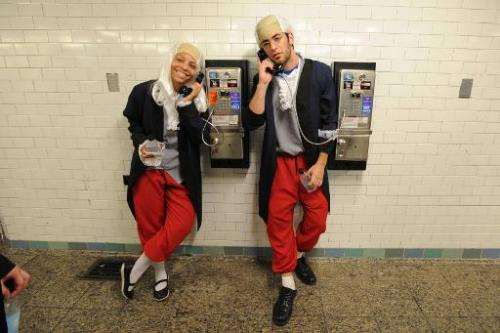 Actors dressed as Benjamin Franklin talk on pay phones on June 29, 2013 in New York City in a campaign by Virgin Mobile which en