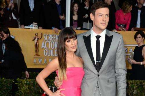 Actress Lea Michele (L) and actor Cory Monteith arrive at the 19th Annual Screen Actors Guild Awards held at The Shrine Auditori