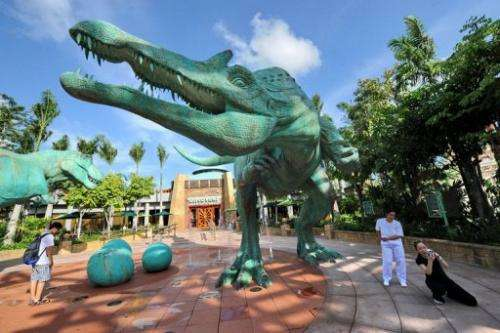 A dinosaur replica outside the Jurassic Park attraction at Universal Studios in Singapore, on March 18, 2010