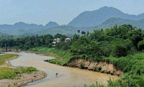 A fisherman casts his net in the Mekong river in Luang Prabang, on May 4, 2012