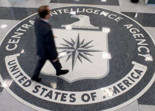 A man crosses the Central Intelligence Agency headquarters lobby in Langley, Virginia, on August 14, 2008